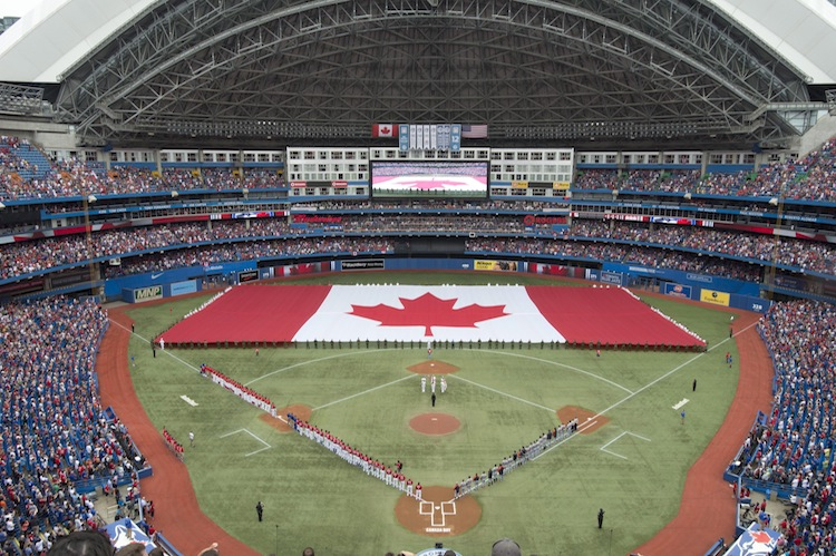 A flag was unfurled on the field during the national anthems before the Toronto Blue Jays took on the Detroit Tigers in Major League Baseball action. (Frank Gunn / The Canadian Press)