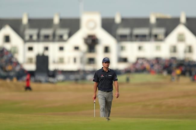 Kevin Kisner of the US walks along the 17th fairway during the third round of the British Open Golf Championship in Carnoustie Scotland Saturday