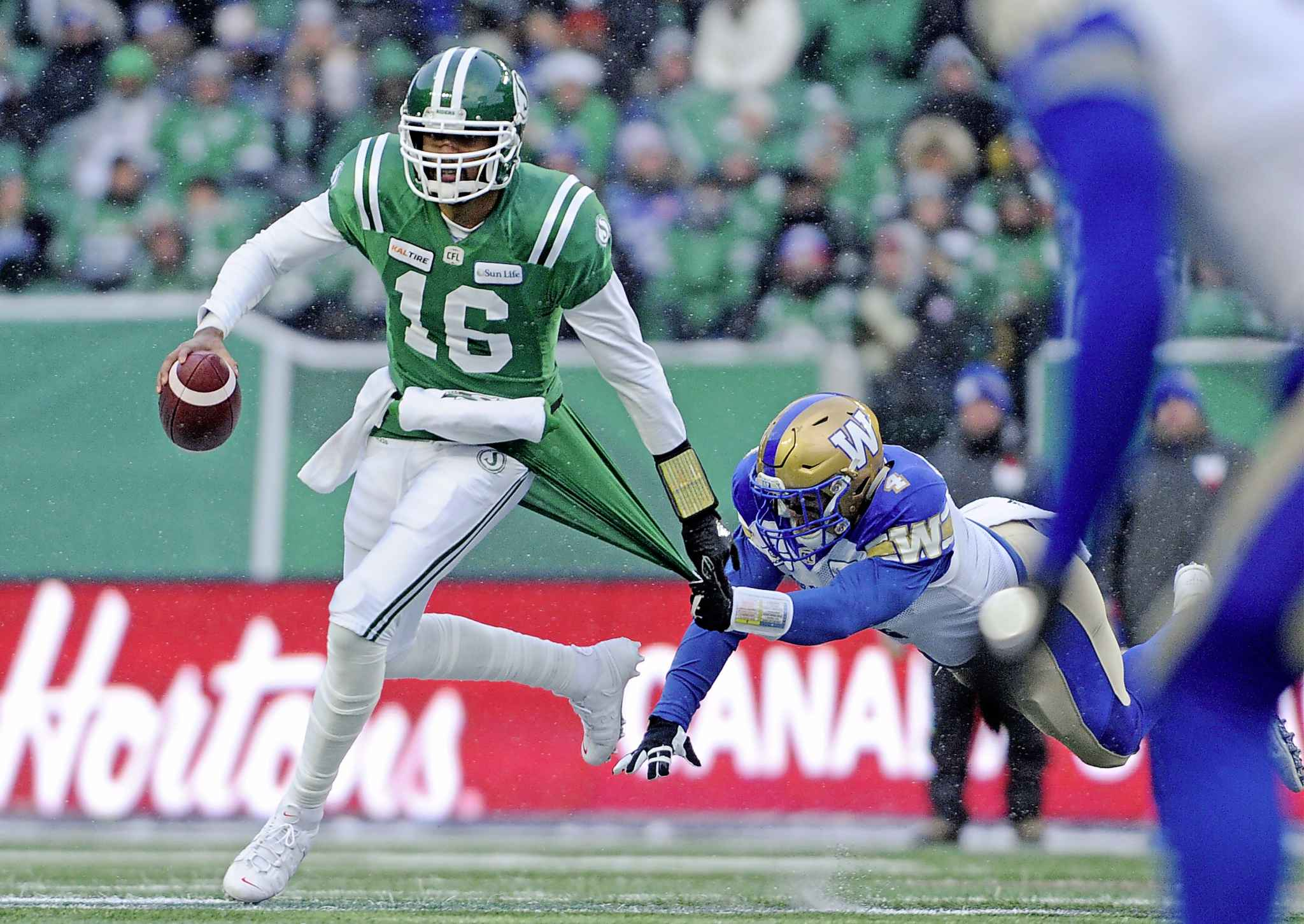 Winnipeg Blue Bombers linebacker Adam Bighill, right, chases down Saskatchewan Roughriders quarterback Brandon Bridge. Bighill's football, soccer and powerlifting coach at Montesano High School, said he had a never-ending motor, the kind of energy-for-days effort Bighill still displays on the football field.