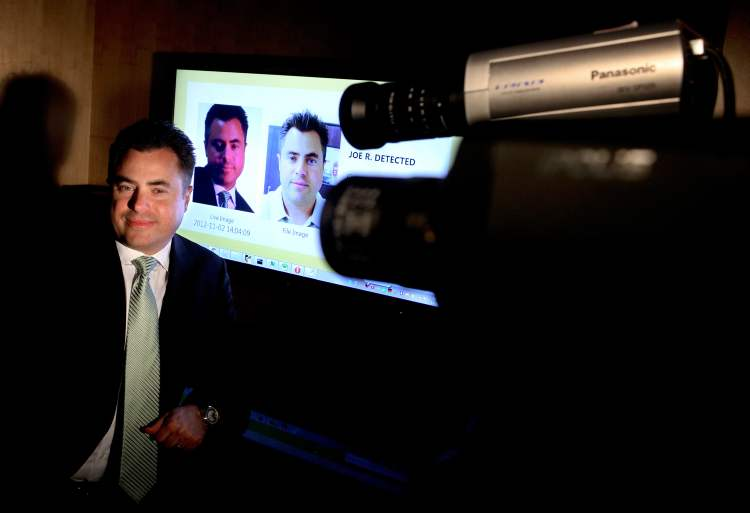 Joseph Rosenkrantz, CEO of Face First, a facial recognition technology company, at the company's Camarillo, California, headquarters on November 2, 2012. On screen in background is a demonstration of their technology.