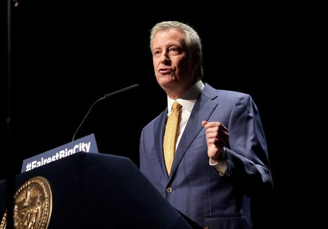 FILE - In this Jan 10, 2019, file photo, New York City Mayor Bill de Blasio speaks at his State of the City address in New York. De Blasio announced his bid with a video released by his campaign early Thursday morning. (AP Photo/Seth Wenig, File)