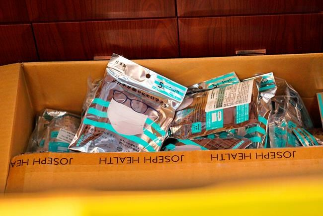 A box of masks imported from Japan sits inside a Yifeng Pharmacy in Wuhan, China, January 22, 2020. Pharmacies in Wuhan are restricting customers to buying one mask at a time amid high demand and worries over an outbreak of a new coronavirus. The number of cases of the new virus has risen to over 400 in China and the death toll to 9, Chinese health authorities said Wednesday. (AP Photo/Dake Kang)