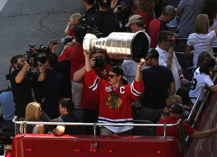 Jonathan Toews holds the Stanley Cup during a victory parade.