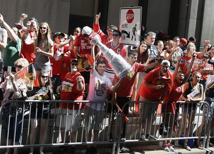 Fans cheer along the parade route. (Nam Y. Huh / The Associated Press)