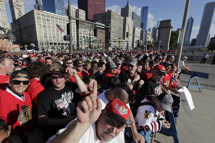 Fans wait to get in to Grant Park for a rally following the victory parade for the Stanley Cup champion Chicago Blackhawks.