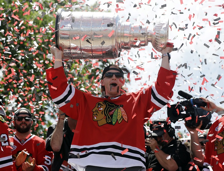 Patrick Kane gets his turn with the Stanley Cup. (Nam Y. Huh / The Associated Press)