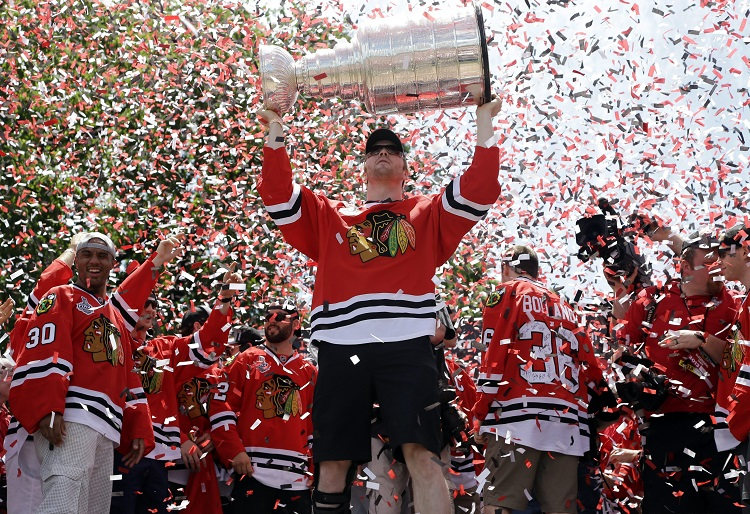 Chicago Blackhawks winger Bryan Bickell holds up the Stanley Cup at the rally in Grant Park. Bickell scored the game-tying goal in Chicago's remarkable late comeback in Game 6 against the Boston Bruins. (Nam Y. Huh / The Associated Press)