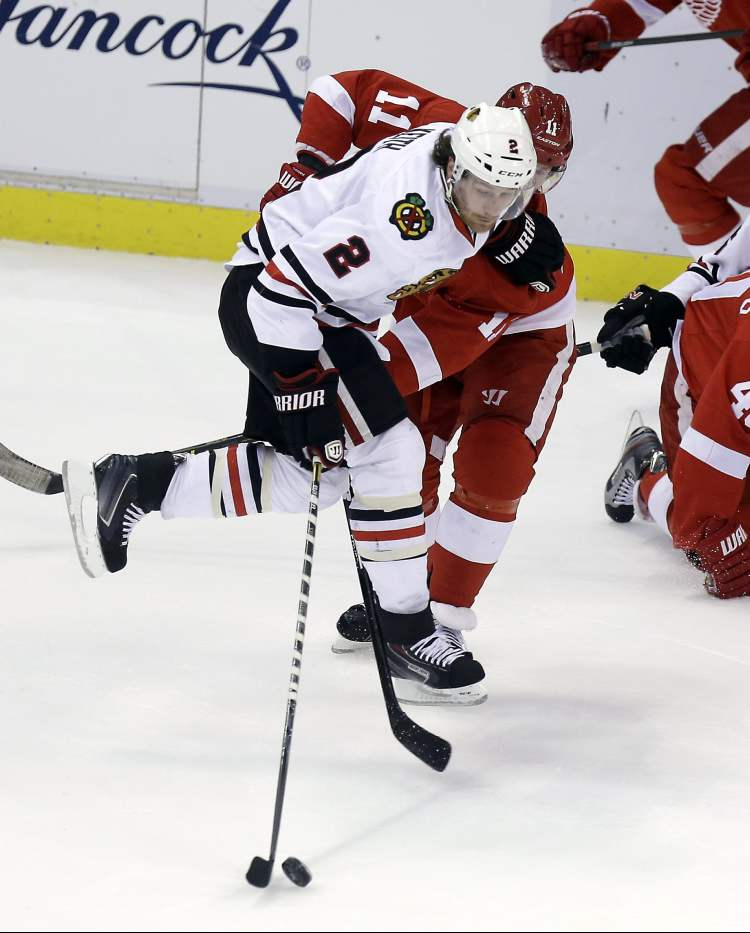 Detroit Red Wings winger Daniel Cleary (11) and Chicago Blackhawks defenceman Duncan Keith (2) chase the puck during the first period.
