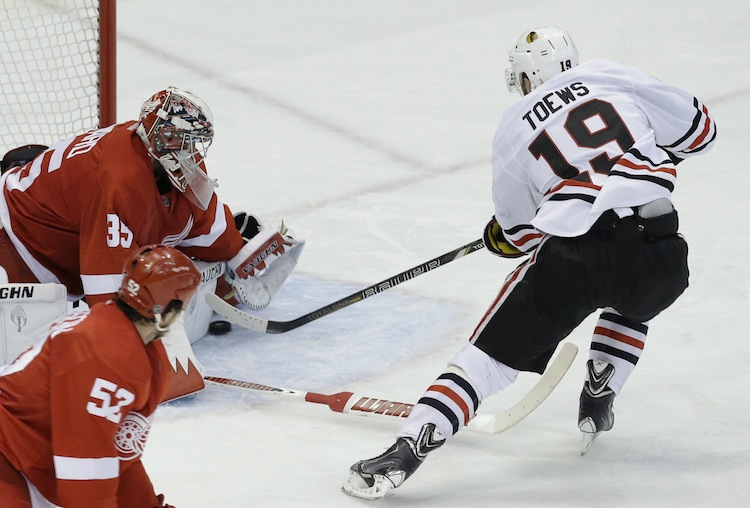 Detroit Red Wings goalie Jimmy Howard stops Jonathan Toews during the second period. (Paul Sancya / The Associated Press)
