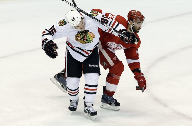 Chicago Blackhawks center Andrew Shaw and Detroit Red Wings defenceman Kyle Quincey (27) collide during the second period. (Paul Sancya / The Associated Press)
