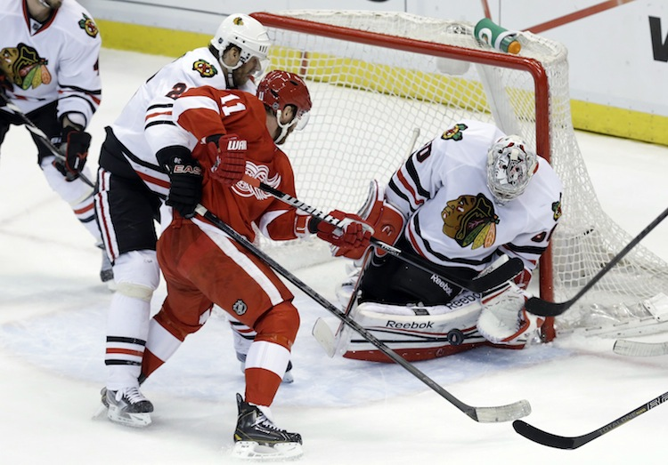Chicago Blackhawks goalie Corey Crawford stops Detroit Red Wings winger Daniel Cleary during the second period. (Paul Sancya / The Associated Press)