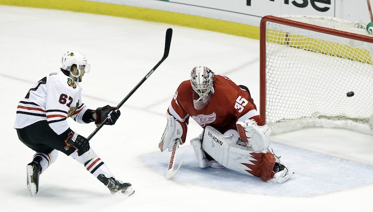 Chicago Blackhawks center Michael Frolik scores on a penalty shot goal in the third period, making it 4-2 Blackhawks. (Paul Sancya / The Associated Press)