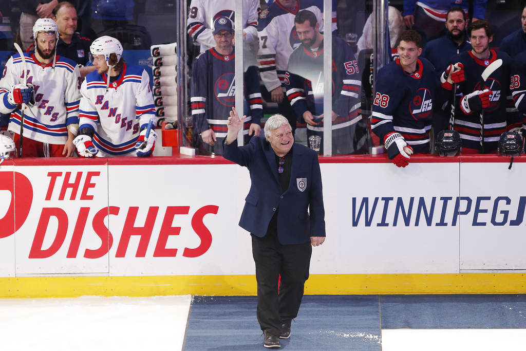 Bobby Hull waves to the crowd during a ceremony honouring Thomas Steen and Randy Carlyle by the Winnipeg Jets Hall of Fame before a Jets home game in February.