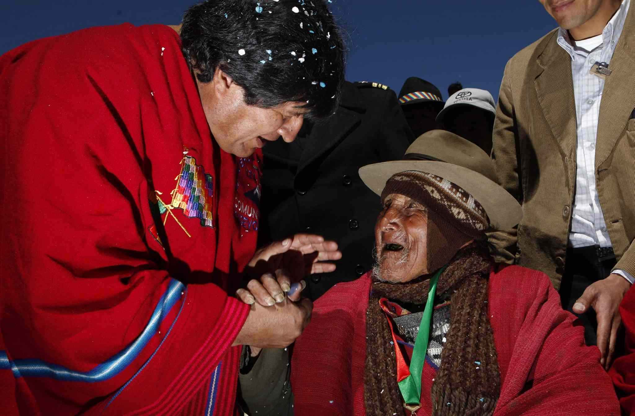 Bolivia's President Evo Morales greets Carmelo Flores, a native Aymara, outside Flores' home in the village of Frasquia, Bolivia, Monday, Sept. 16, 2013. If Bolivia's public records are correct, Flores is the oldest living person ever documented. They say he turned 123 in July.