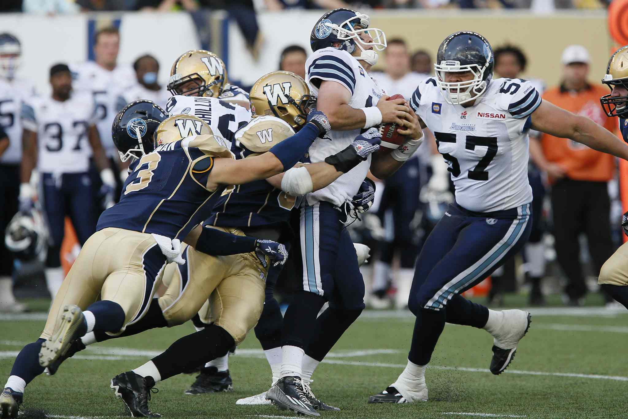 Winnipeg Blue Bombers defensive lineman Greg Peach is the lead tackler as the Bombers defence sacks Toronto Argonauts quarterback Mitchell Gale during the first half of a CFL pre-season game at Investors Group Field in Winnipeg Monday.