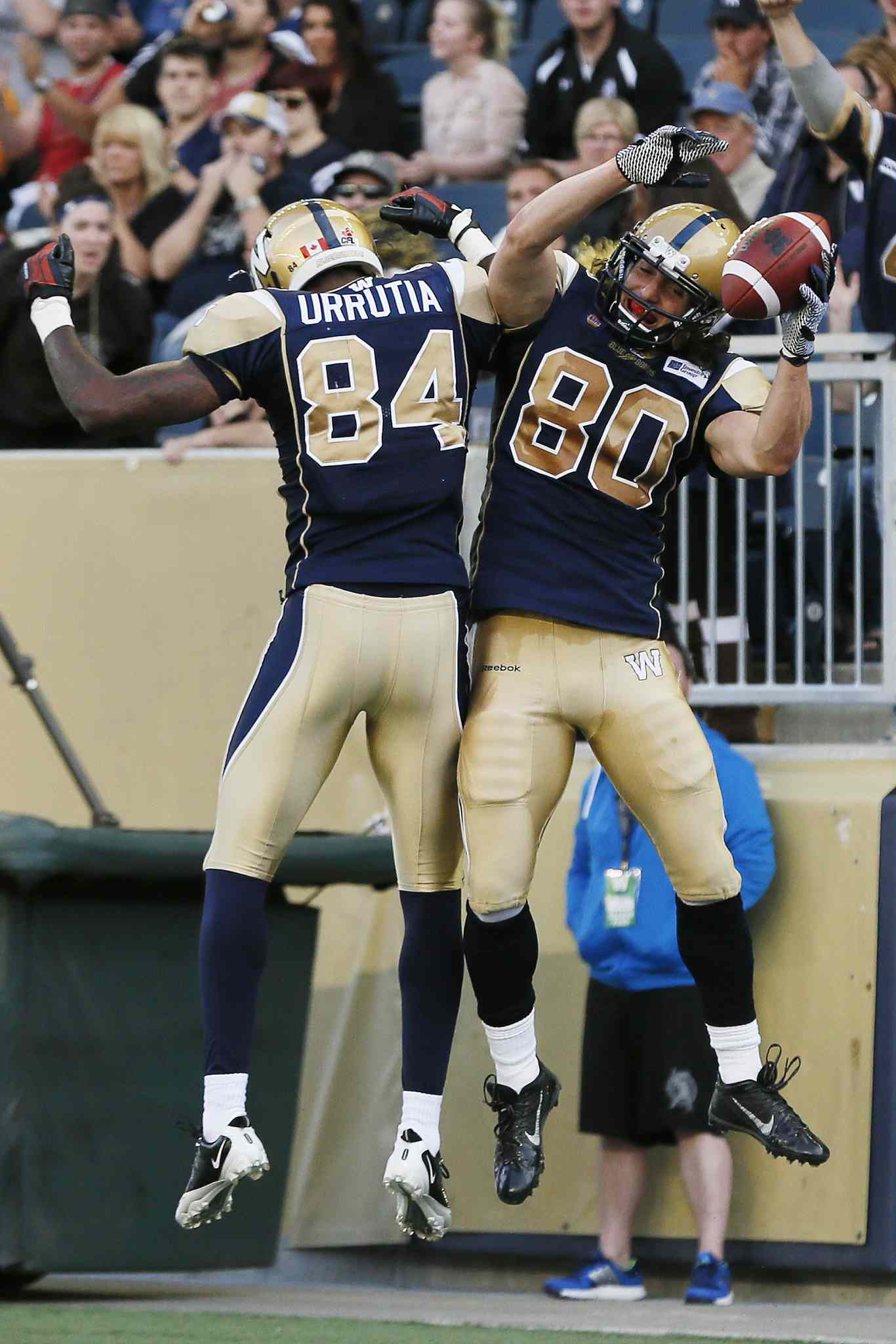 Bombers prospects Mario Urrutia, left, and Julian Feoli-Gudino celebrate Feoli-Gudino's first-half touchdown against the Argonauts.