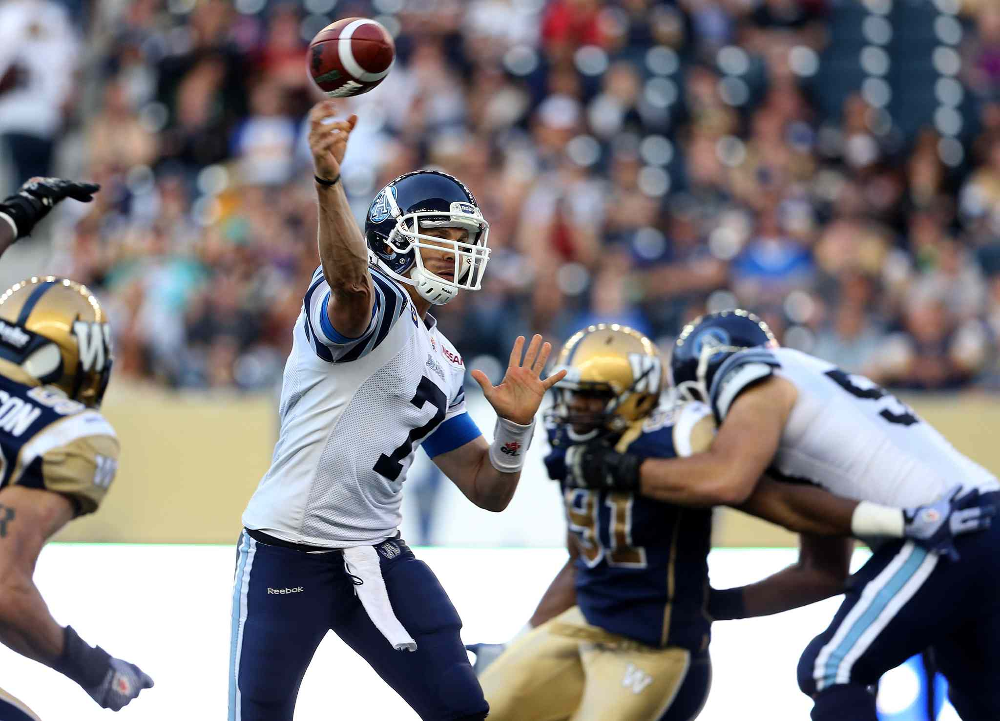 Argos quarterback Trevor Harris fires a pass during the first half.