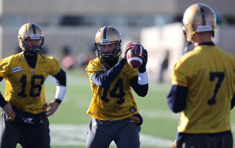 Winnipeg Blue Bombers quarterbacks Justin Goltz (18), Joey Elliot (14) and Alex Brink (7) practise at Canad Inns Stadium on Saturday in preparation for Sunday's game in Montreal.