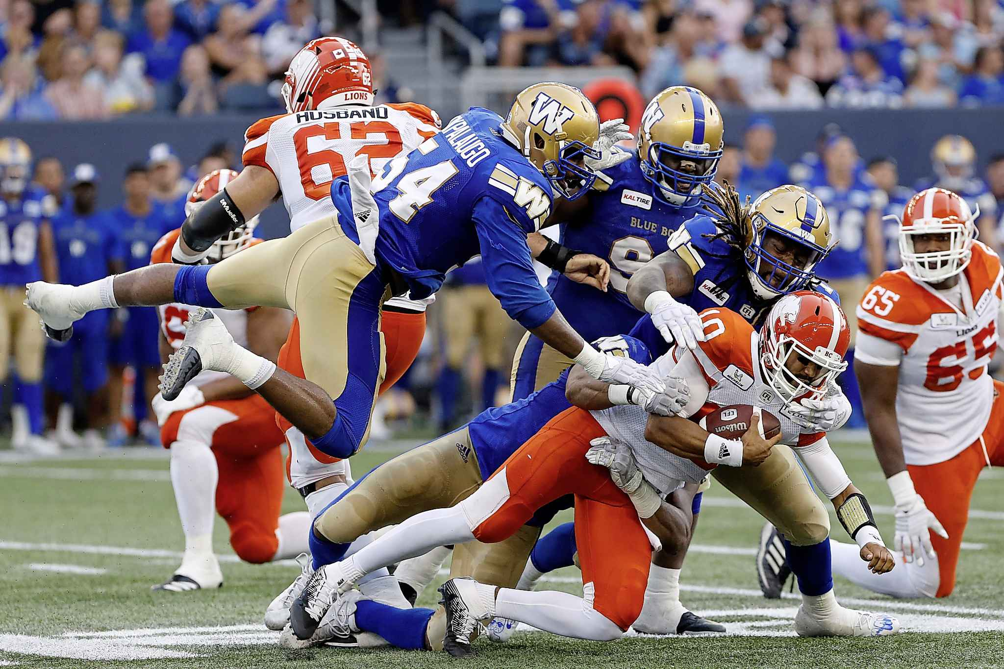 Winnipeg Blue Bombers sack BC Lions quarterback Jonathon Jennings during the first half of CFL action in Winnipeg last week. The Bombers are expecting a stiffer test from the Lions in their rematch, Saturday.