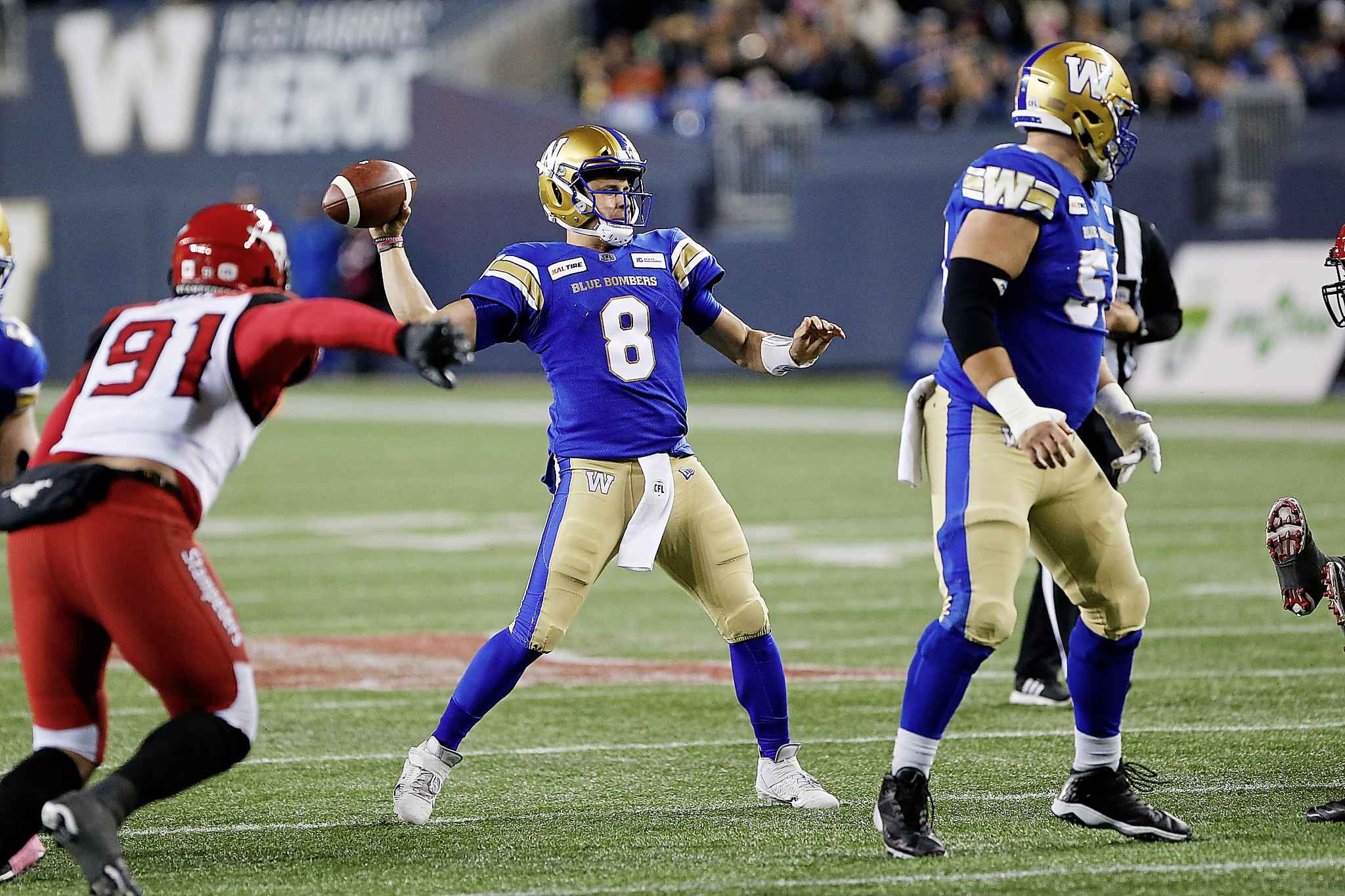Winnipeg Blue Bombers quarterback Zach Collaros throws against the Calgary Stampeders during the first half in Winnipeg Friday.