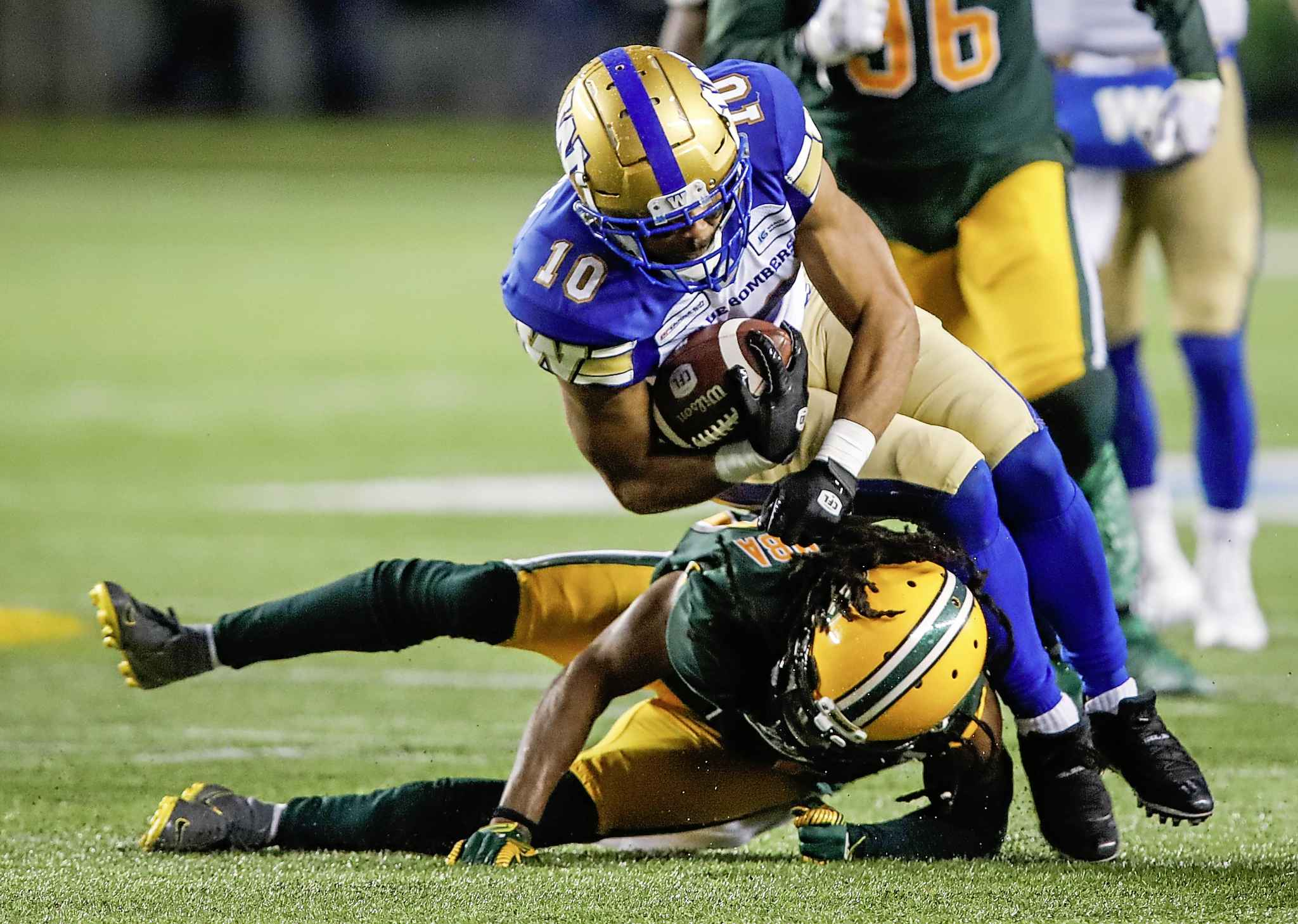 Winnipeg Blue Bombers' Nic Demski, right, is tackled by Edmonton Eskimos' Don Unamba during the second half.