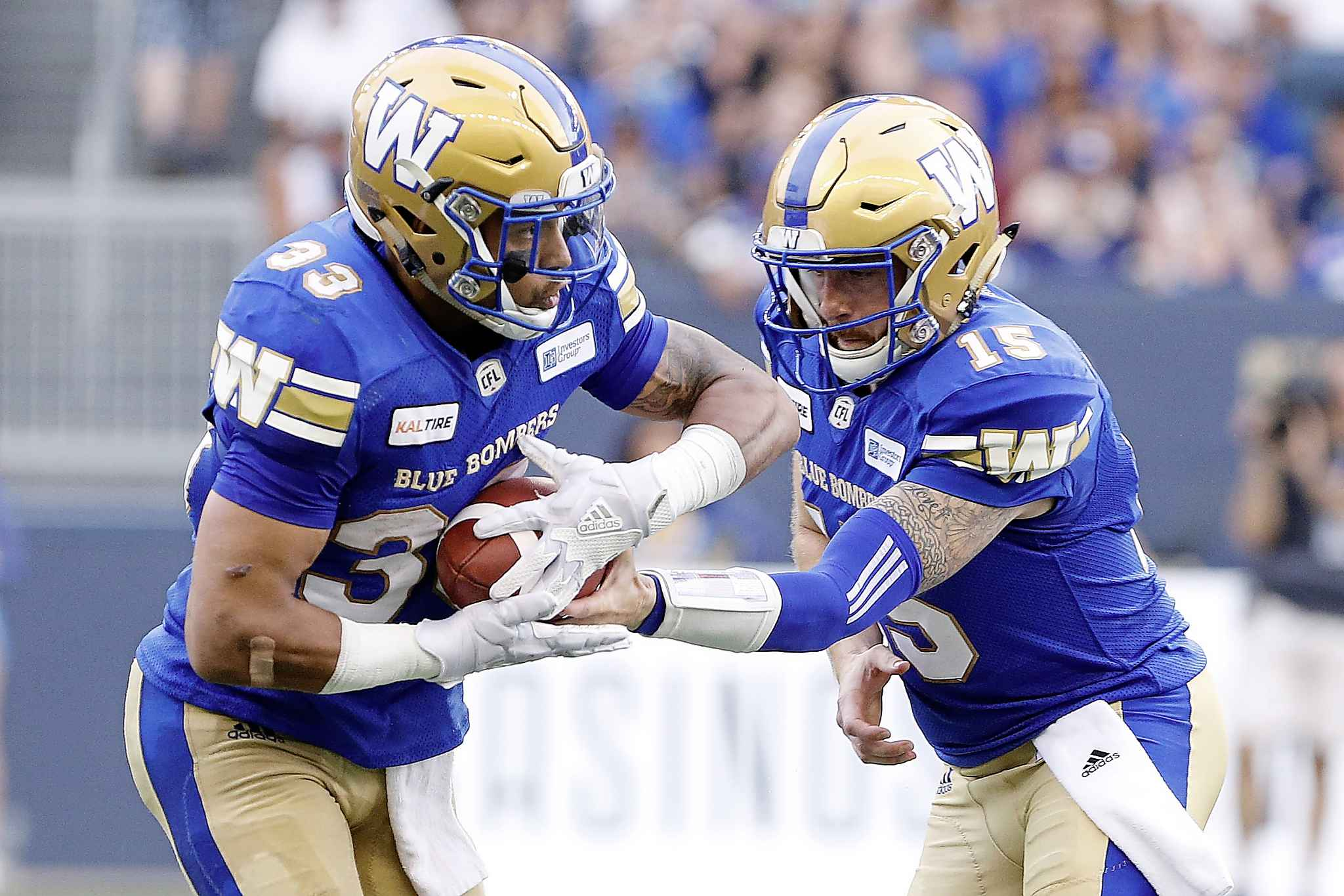 Winnipeg Blue Bombers quarterback Matt Nichols hands off to Andrew Harris during the first half against the BC Lions last Saturday.