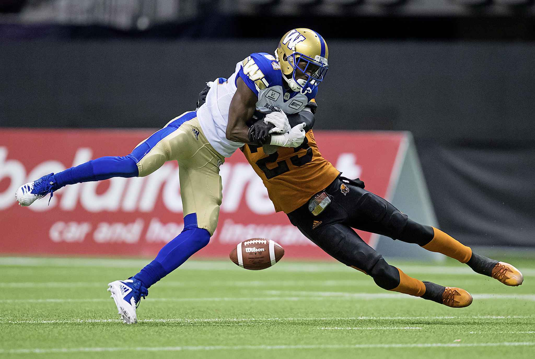B.C. Lions' Anthony Thompson, right, breaks up a pass intended for Winnipeg Blue Bombers' Ryan Lankford during the first half of a pre-season CFL football game in Vancouver, on Friday June 8, 2018. THE CANADIAN PRESS/Darryl Dyck