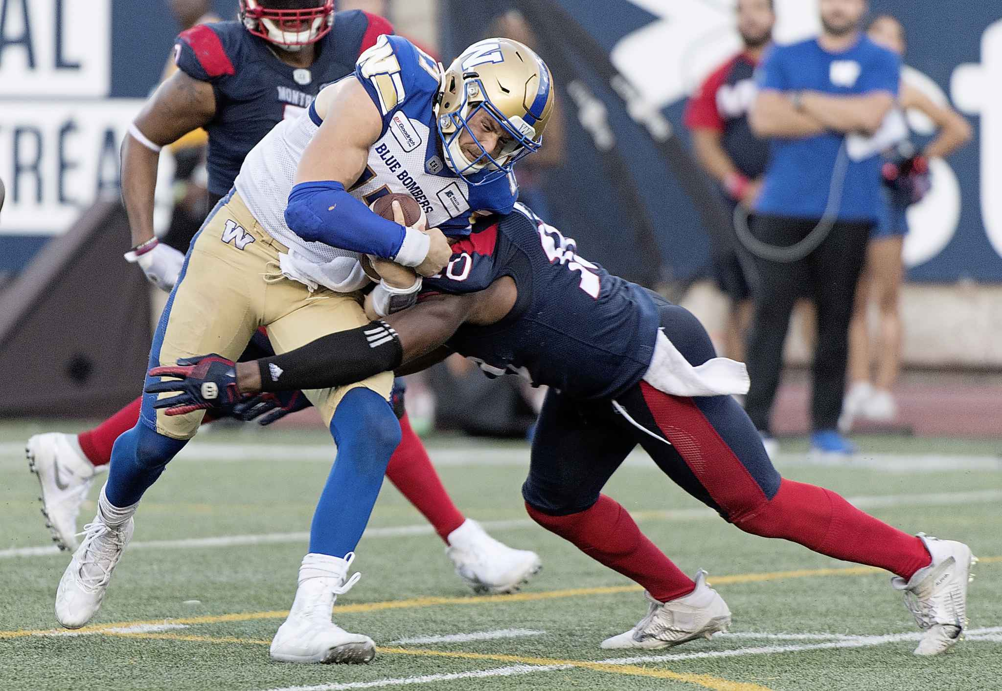 Winnipeg Blue Bombers quarterback Chris Streveler, left, is tackled by Montreal Alouettes linebacker Henoc Muamba during the Alouettes' come-from-behind win against the Bombers in September.