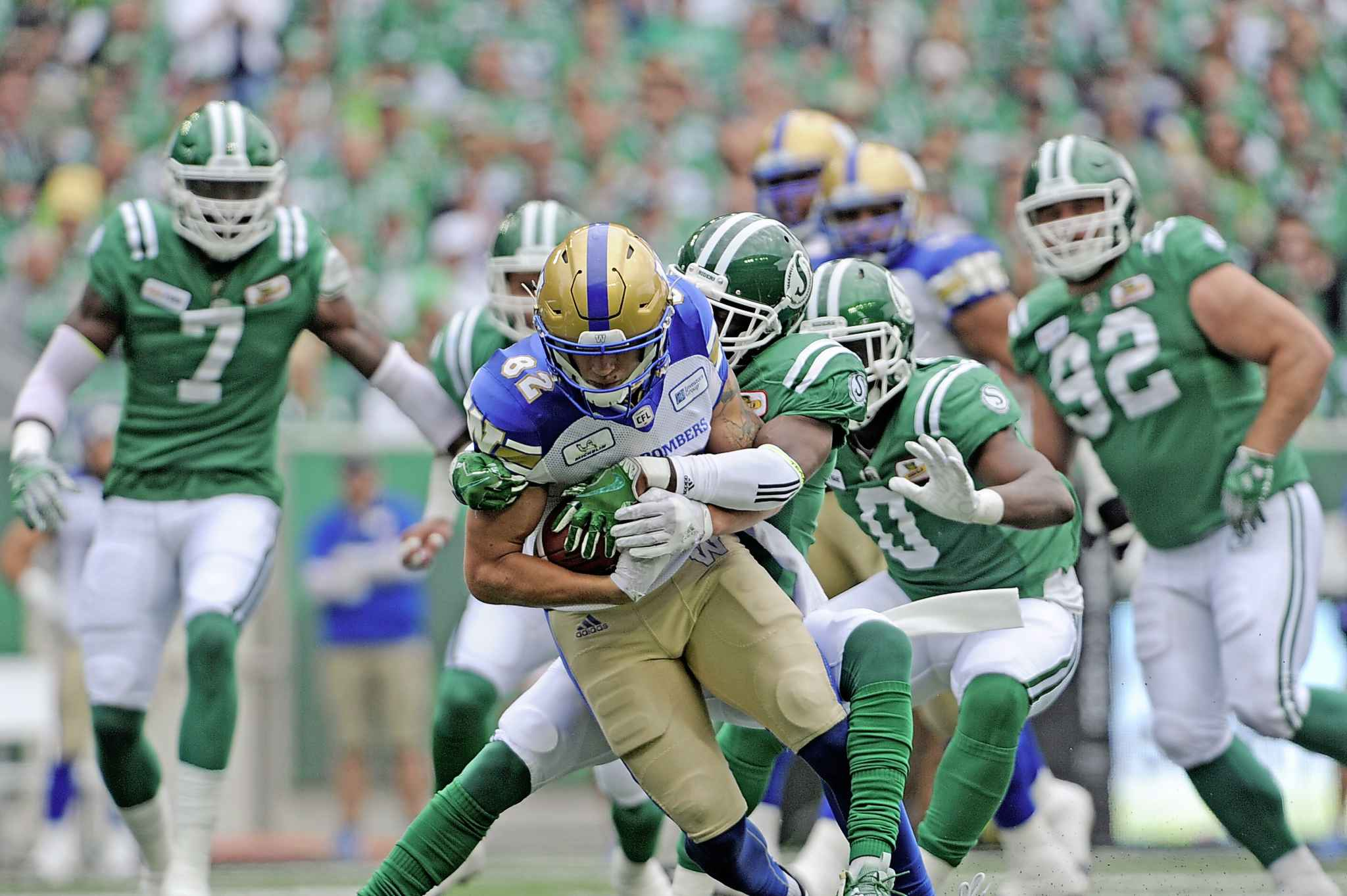 Wolitarsky protects the ball while he runs against the Saskatchewan Roughriders defence.