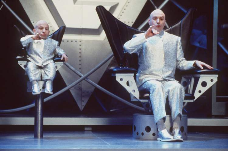 "Mike Myers, right, and Verne J. Troyer perform in a scene from New Line Cinema's comedy ""Austin Powers: The Spy Who Shagged Me."" The movie, a James Bond spoof, stars Mike Myers as the sexually charged man of mystery. The ""Austin Powers"" movies have done the best Bond parodies.  (Handout)"