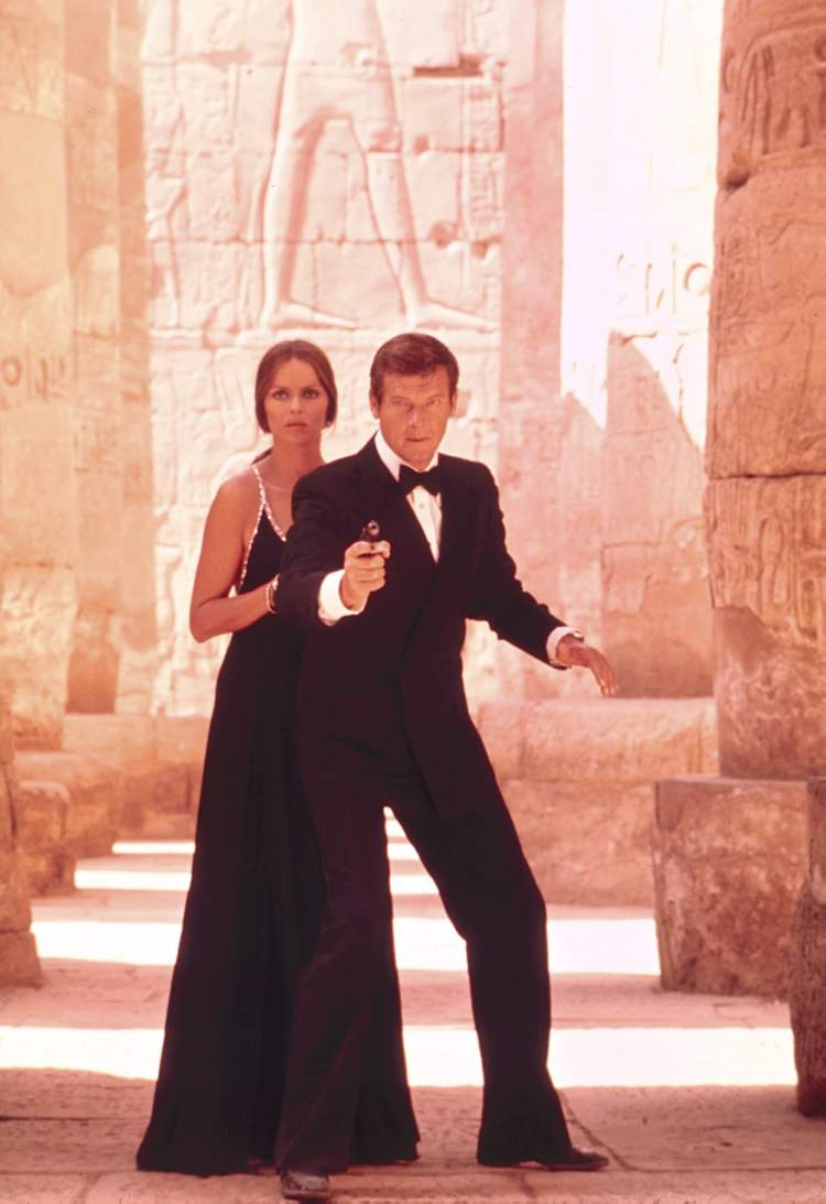 "Roger Moore, right, as James Bond, and Barbara Bach as Major Anya Amasova, in the 1977 film, ""The Spy Who Loved Me."" Moore, played Bond in seven films, more than any other actor. (The Associated Press / United Artists and Danjaq, LLC)"
