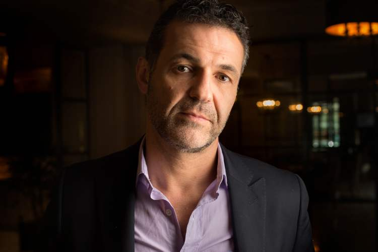 Khaled Hosseini, whose latest book is 'And the Mountains Echoed,' was born in Afghanistan but his family was exiled and eventually came to the United States. In his novels and life, Hosseini grapples with issues of separation and displacement.