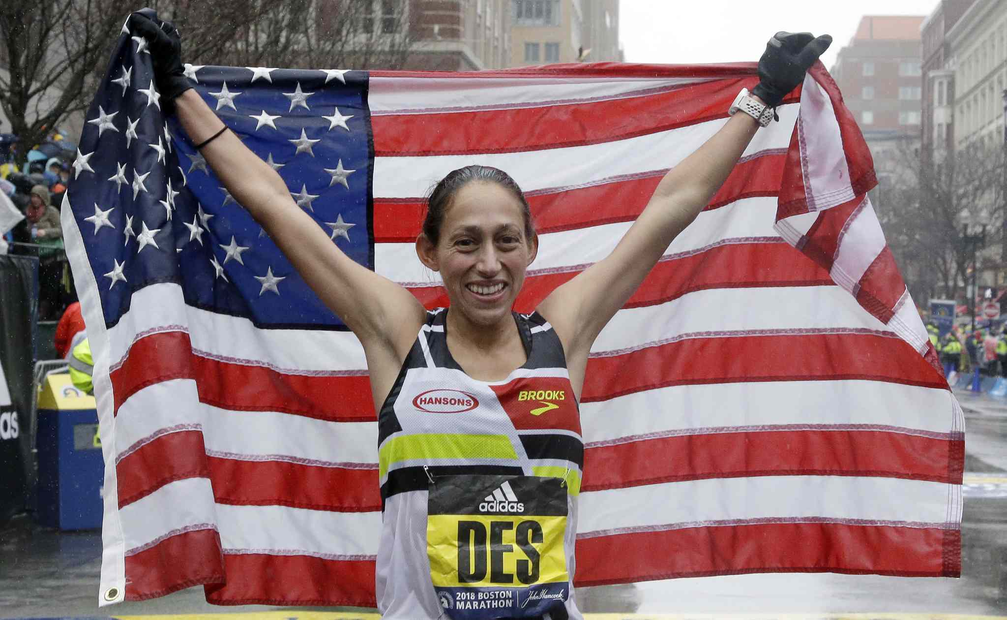 Desiree Linden, of Washington, Mich., celebrates after winning the women's division of the 122nd Boston Marathon on Monday, April 16, 2018, in Boston. She is the first American woman to win the race since 1985. (AP Photo/Elise Amendola)