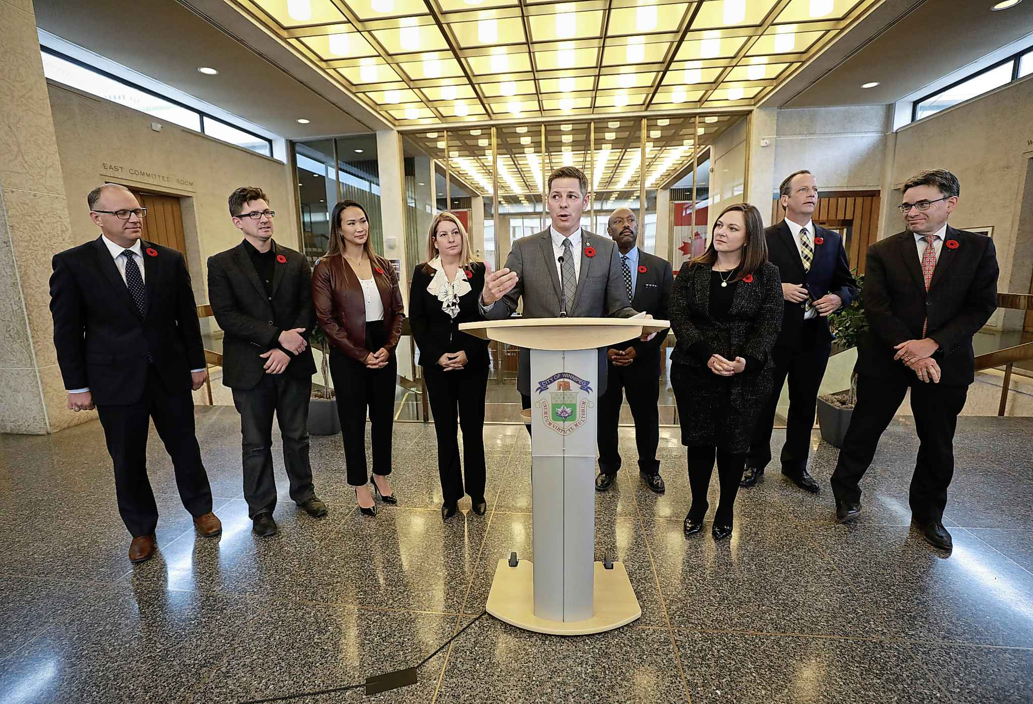 Winnipeg Mayor Brian Bowman introducing members of his EPC at city hall last November. City councillors get a $23,000 pay increase when they become EPC members.