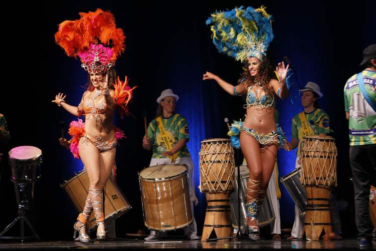 Dancers in colourful costumes perform in the Brazilian pavilion.  (JOHN WOODS / WINNIPEG FREE PRESS)