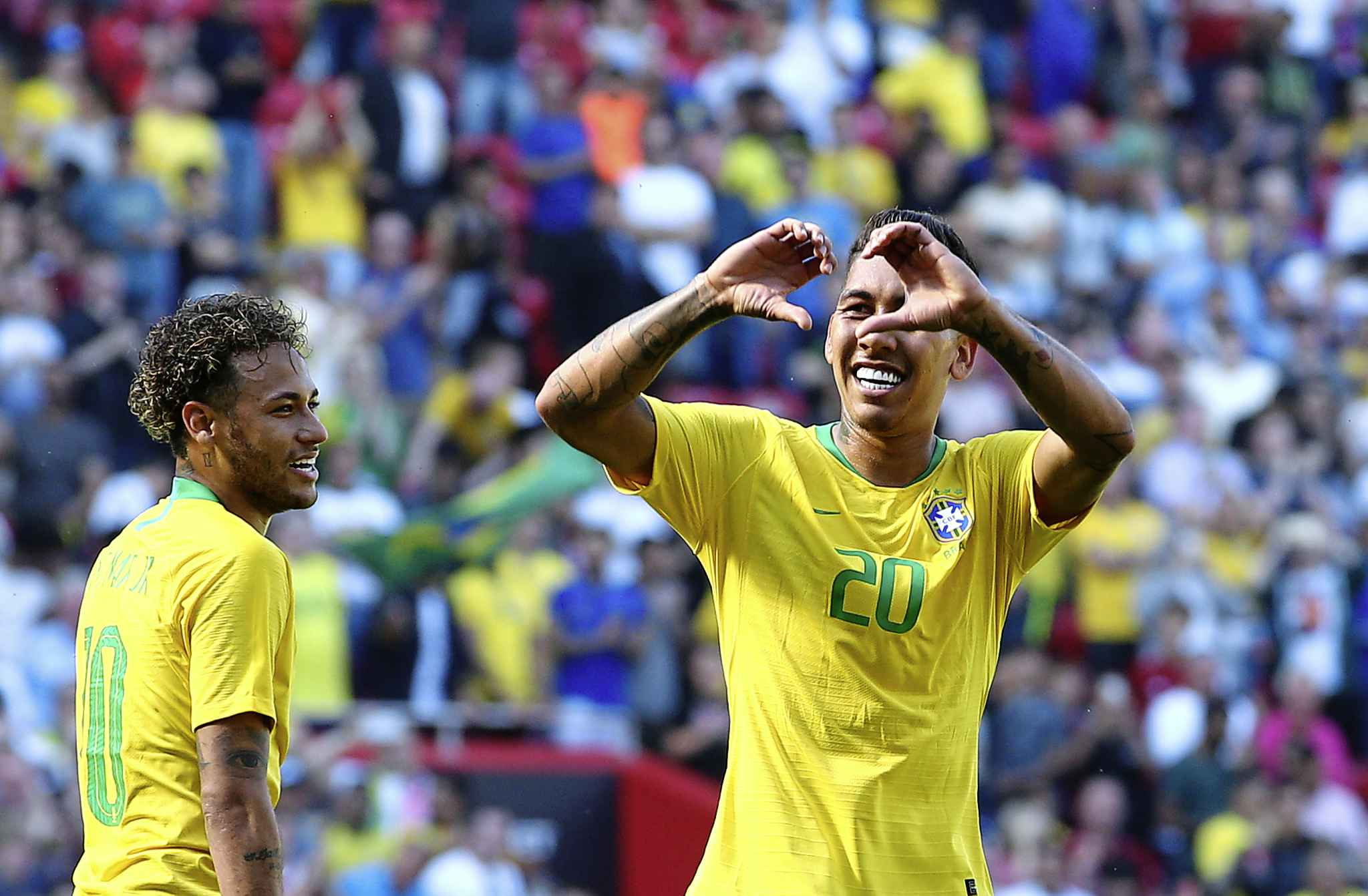 When Neymar, left, scored against Croatia, he took over third-place on his country's all-time list. (Dave Thompson / Associated Press files)