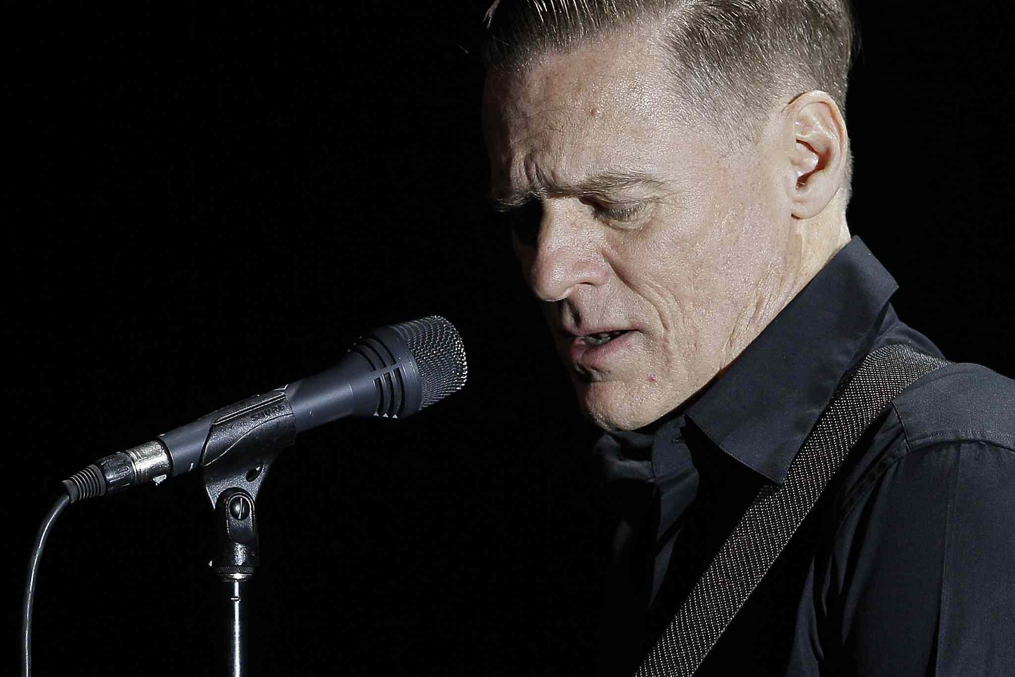 Bryan Adams performs at the Centennial Concert Hall in Winnipeg Monday. The Canadian pop legend is in the midst of his acoustic Bare Bones Tour with pianist Gary Breit.