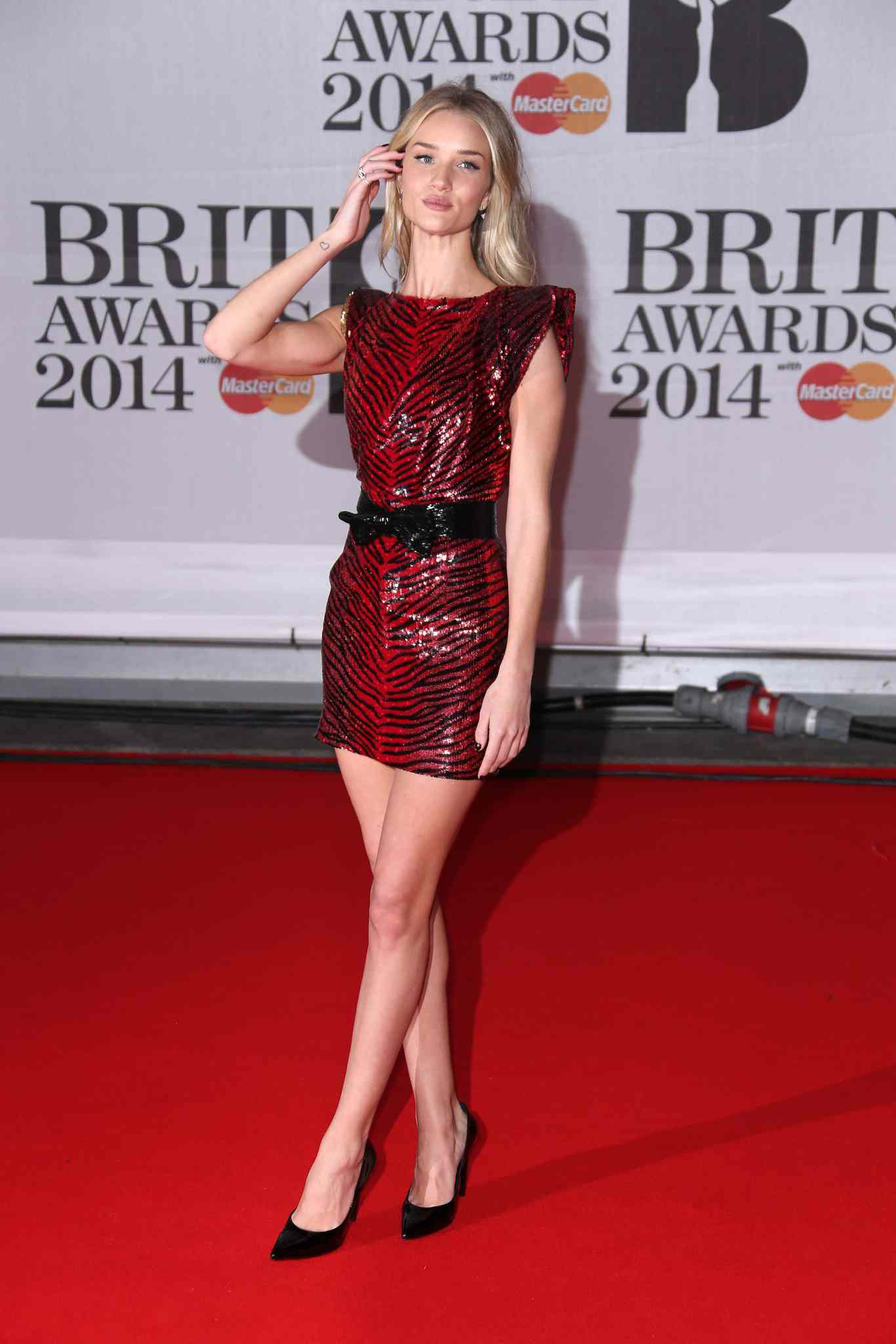 British model Rosie Huntington-Whiteley arrives at the BRIT Awards 2014 at the O2 Arena in London on Wednesday.