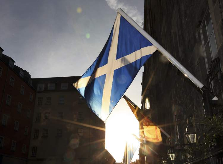A view of a Saltire flag also known as Saint Andrew's Cross, the flag of Scotland is seen flying on the side of a building in Edinburgh, Scotland. Scottish authorities announced they will hold a referendum on independence in 2014, firing the starting pistol on a contest that could end in the breakup of Britain.