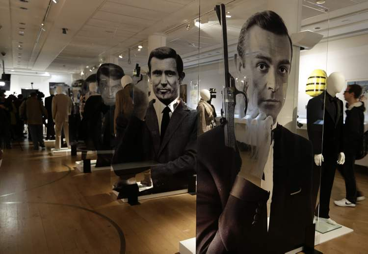 A general view of the James Bond movie memorabilia charity auction at Christie's auction house during the press pre-view showing large portraits of the actors who have portrayed the famous movie icon James Bond, with Sean Connery, at right, in London, Friday, Sept. 28, 2012.  (Alastair Grant / The Associated Press Archives)