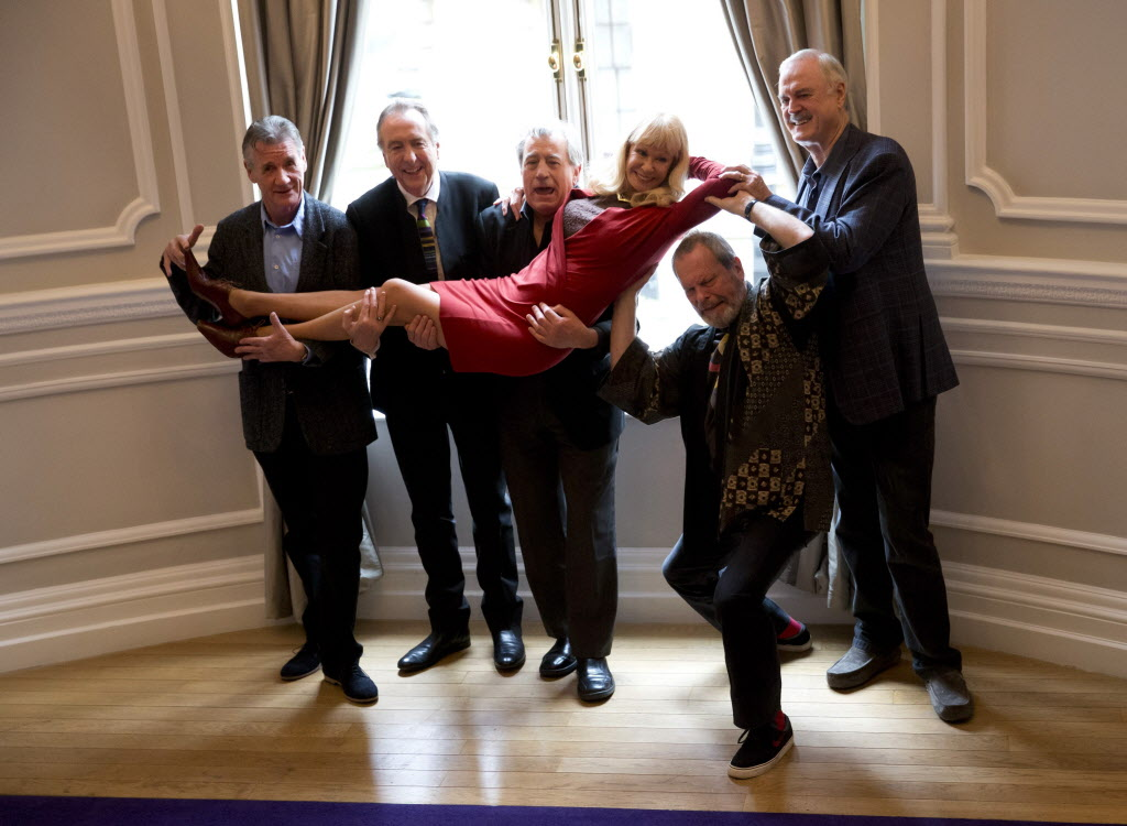 Monty Python members (from left), Michael Palin, Eric Idle, Terry Jones, Terry Gilliam, and John Cleese pick up their co-star, Carol Cleveland.