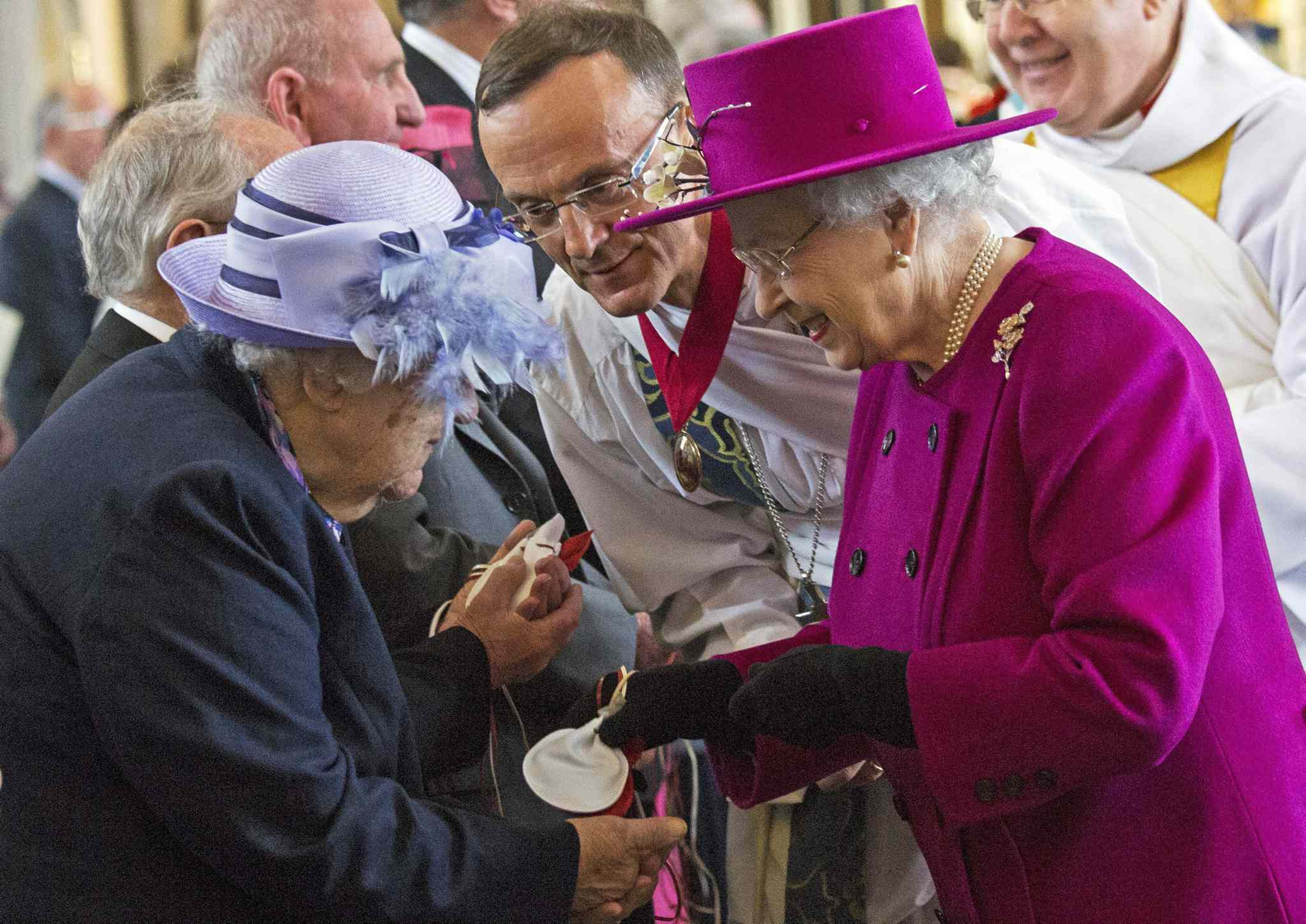 Britain's Queen Elizabeth II (right) speaks with pensioner Mrs Bradshaw during the Maundy Thursday service in Blackburn, England. Maundy Thursday is the Christian holy day falling on the Thursday before Easter. It commemorates the Maundy and Last Supper of Jesus Christ with the Apostles. The Queen commemorates Maundy by offering 'alms' to retired pensioners recommended by clergy and ministers of all denominations, in recognition of service to the church and to the local community.