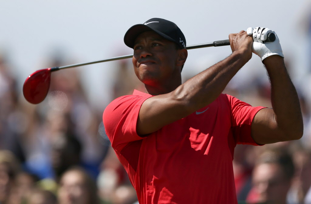 Tiger Woods of the US plays a shot off the 16th tee during the final round of the British Open Golf championship at the Royal Liverpool golf club, Hoylake, England, Sunday.   (Jon Super / AP Photo)