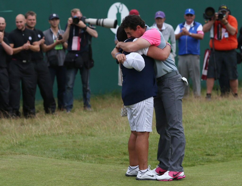 Rory McIlroy of Northern Ireland celebrates winning the British Open Golf championship with his mother Rosie after the final round at the Royal Liverpool golf club, Hoylake, England, Sunday.  McIlroy shot a final round of 71 to seal his victory at the Open.  The 25-year-old was 17 under par for the tournament.   (Scott Heppell / AP Photo)