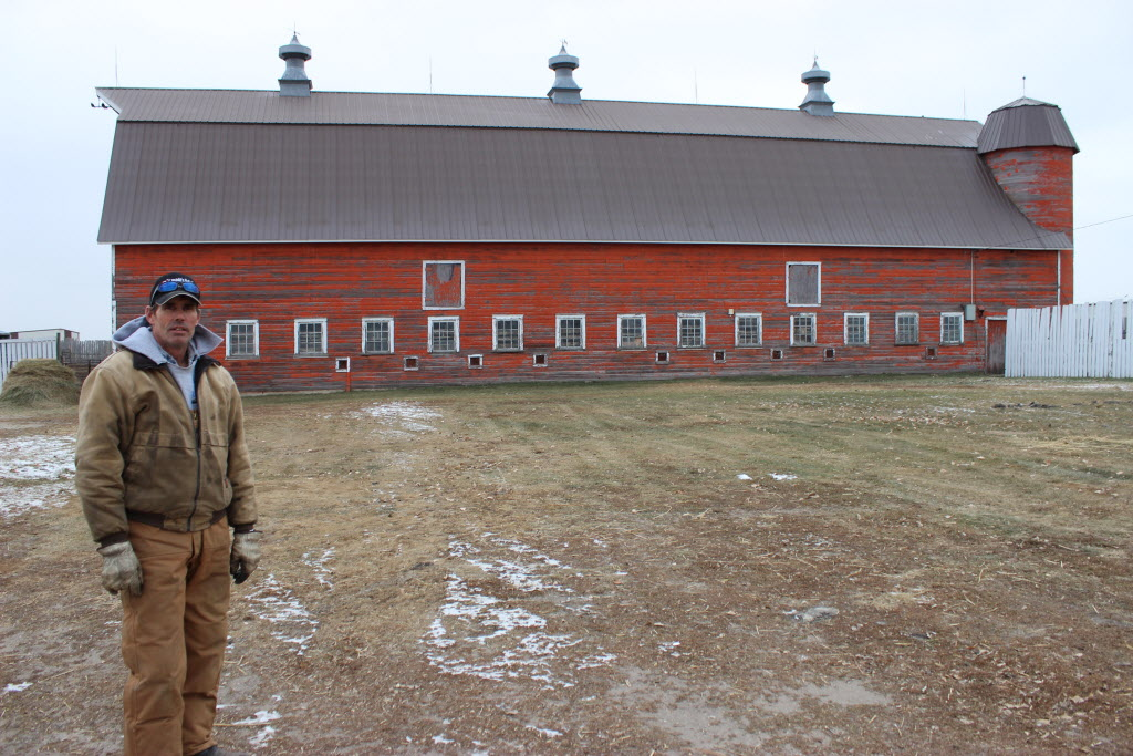 Curtis Gervin and his massive barn that was built in 1924, near Broomhill, more than 300 kilometres southwest of Winnipeg.