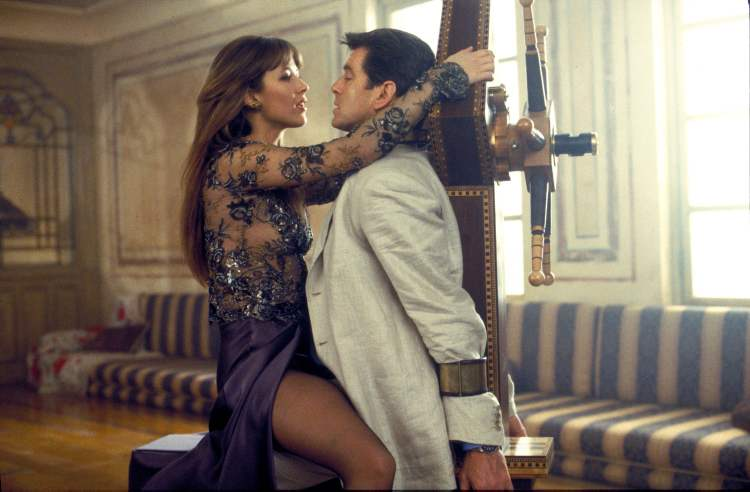Sophie Marceau, left, and Pierce Brosnan in a scene from the James Bond film, The World Is Not Enough.  (The Associated Press)
