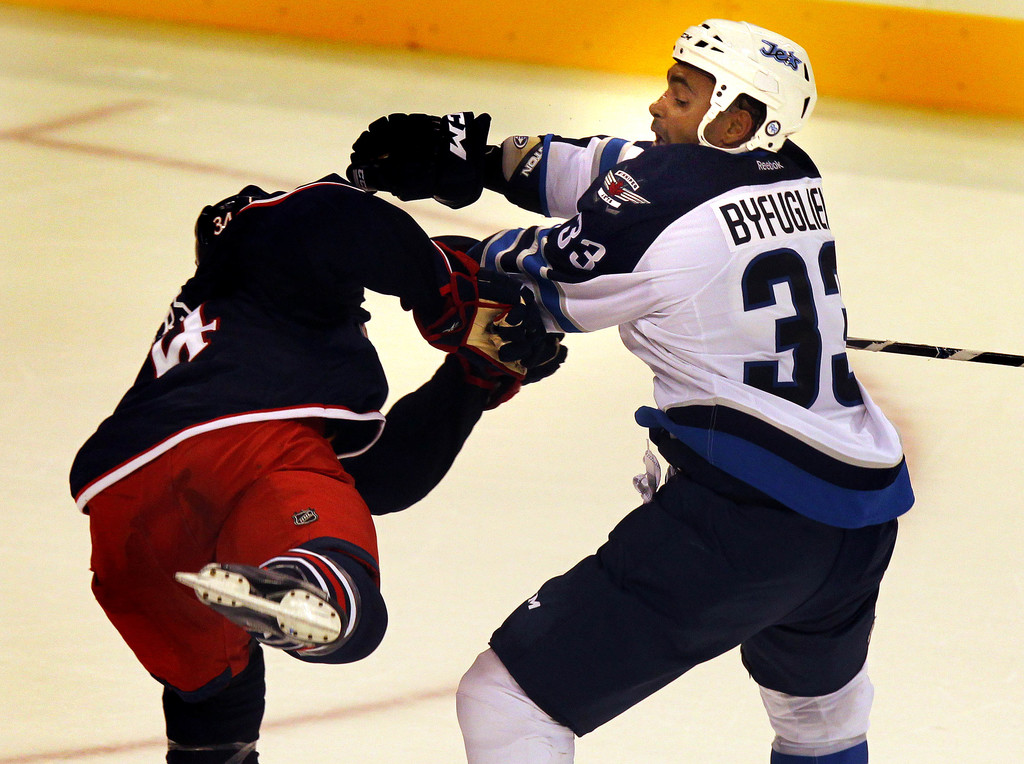 Jets defenceman Dustin Byfuglien set the tone early for his time in WInnipeg, dishing out several big hits in the team's very first game at MTS Centre, a pre-season tilt against the Columbus Blue Jackets on September 20, 2011.
