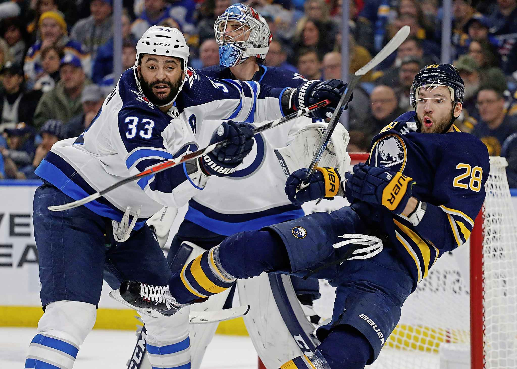Byfuglien ruffs up Buffalo Sabres forward Zemgus Girgensons. Byfuglien had a unique combination of size, skill and sandpaper.
