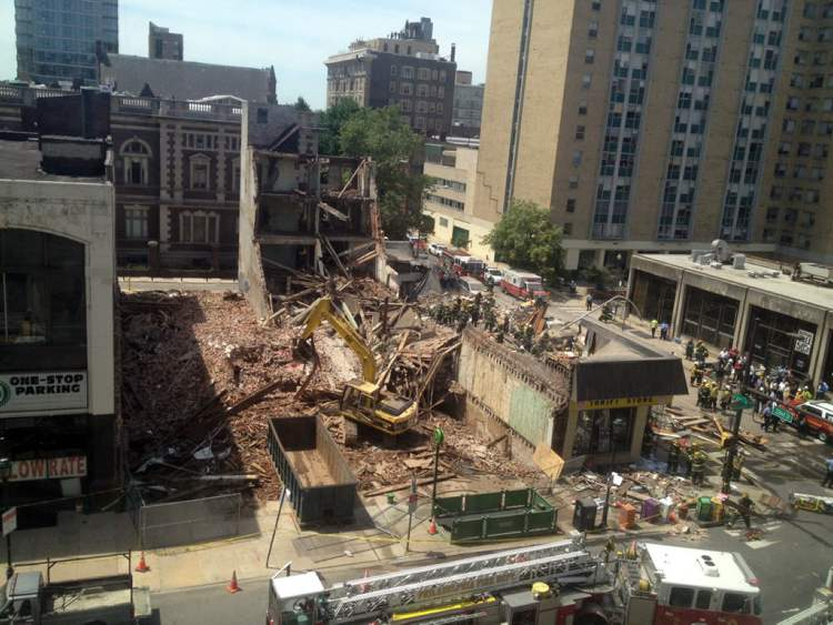 The remaining rubble after the four-storey building collapsed in central Philadelphia. (Dino Hazell / The Associated Press)