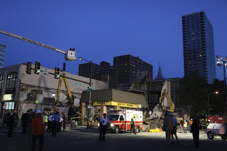 Emergency personnel work into Wednesday evening. (Andrew Renneisen / The Associated Press)
